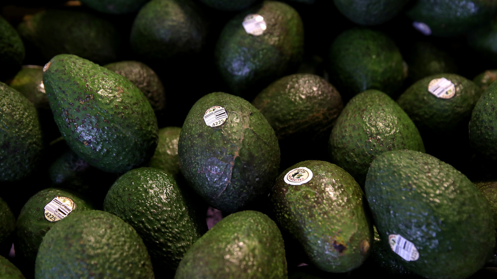 Bin of avocados at the store