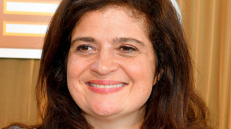 Alex Guarnaschelli smiling and looking off
