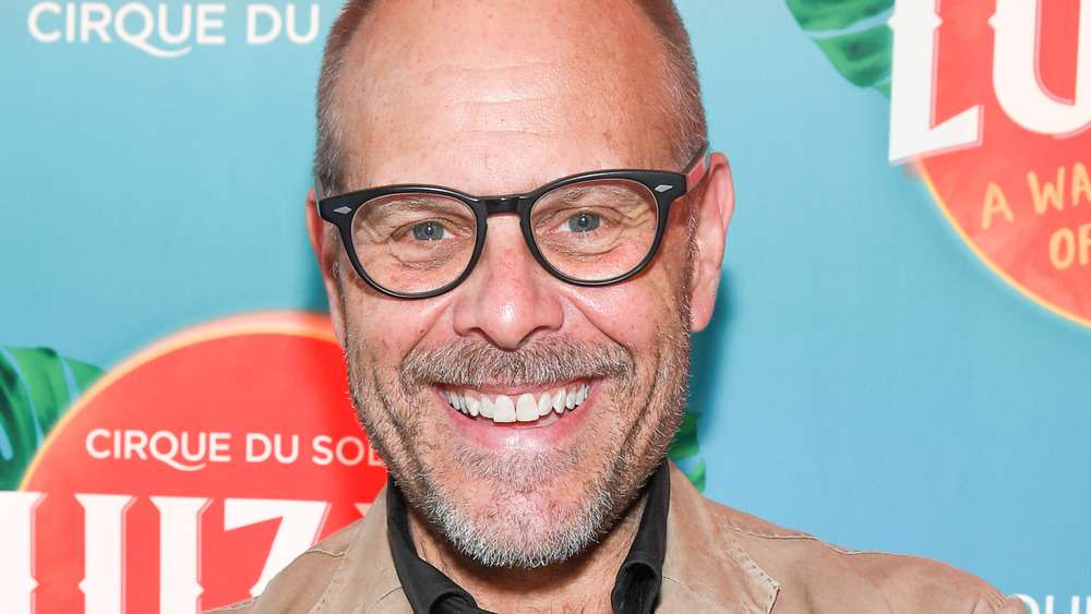 Alton Brown smiling at event