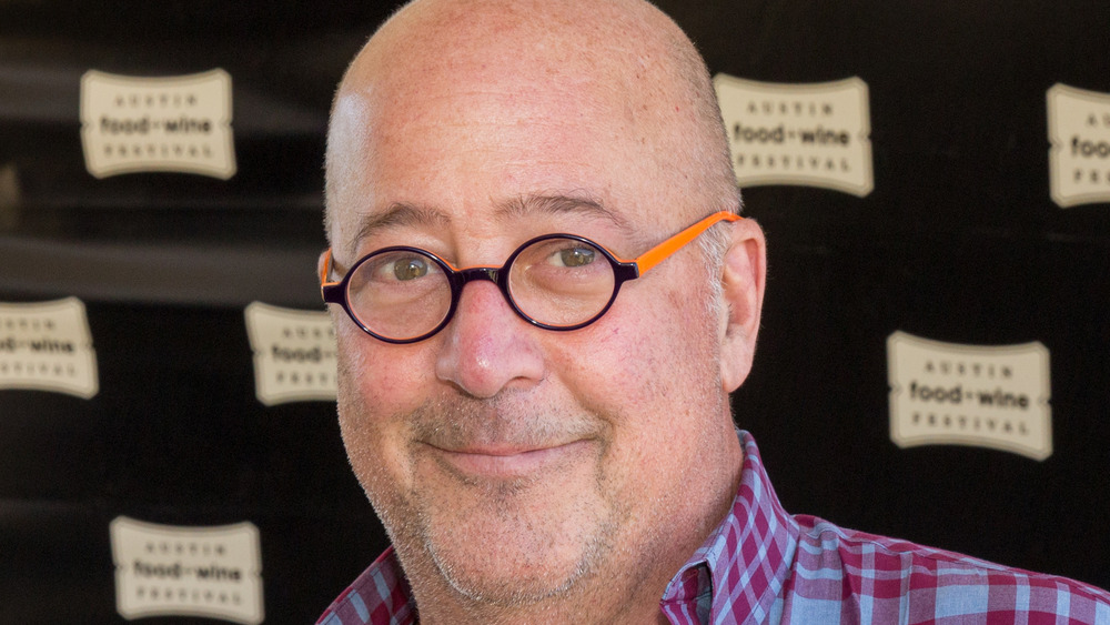 Andrew Zimmern wearing glasses