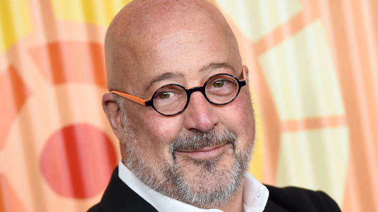 Andrew Zimmern in black and orange glasses