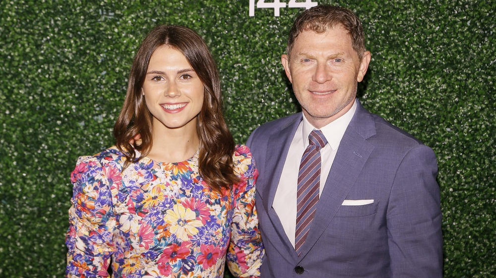 bobby and sophie flay standing in front of green background