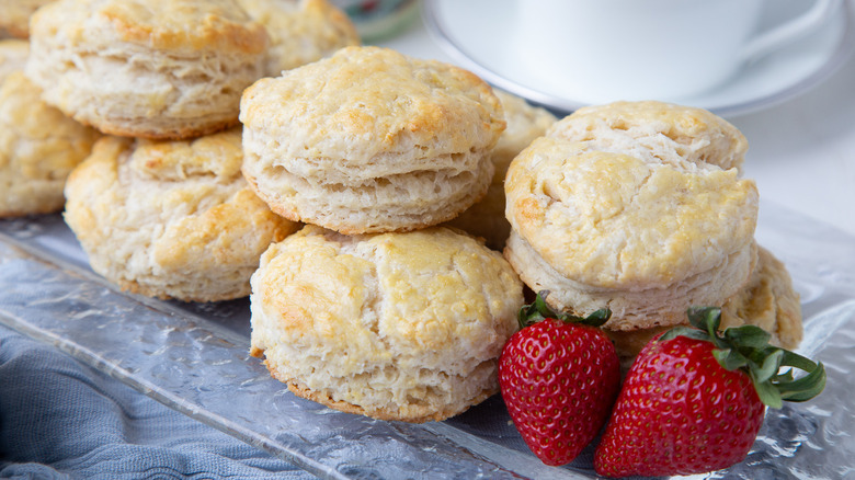 scones on glass plate with strawberries