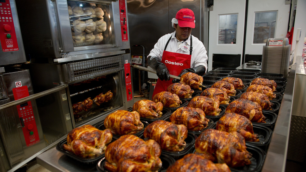 Costco rotisserie chickens being packaged