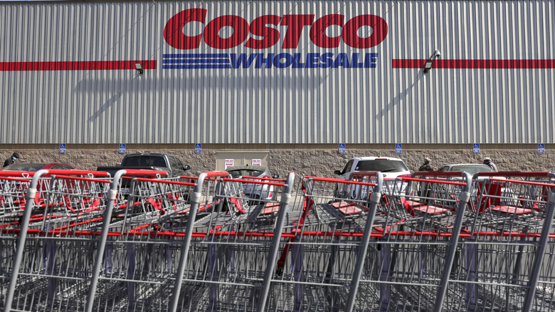 Costco logo on exterior building next to shopping carts