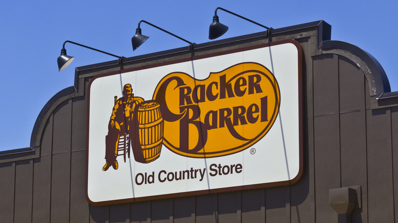 Yellow and brown Cracker Barrel logo on building