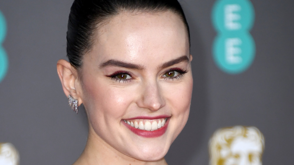 Daisy Ridley smiling big