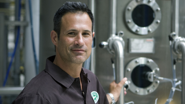 Sam Calagione poses with brewing equipment