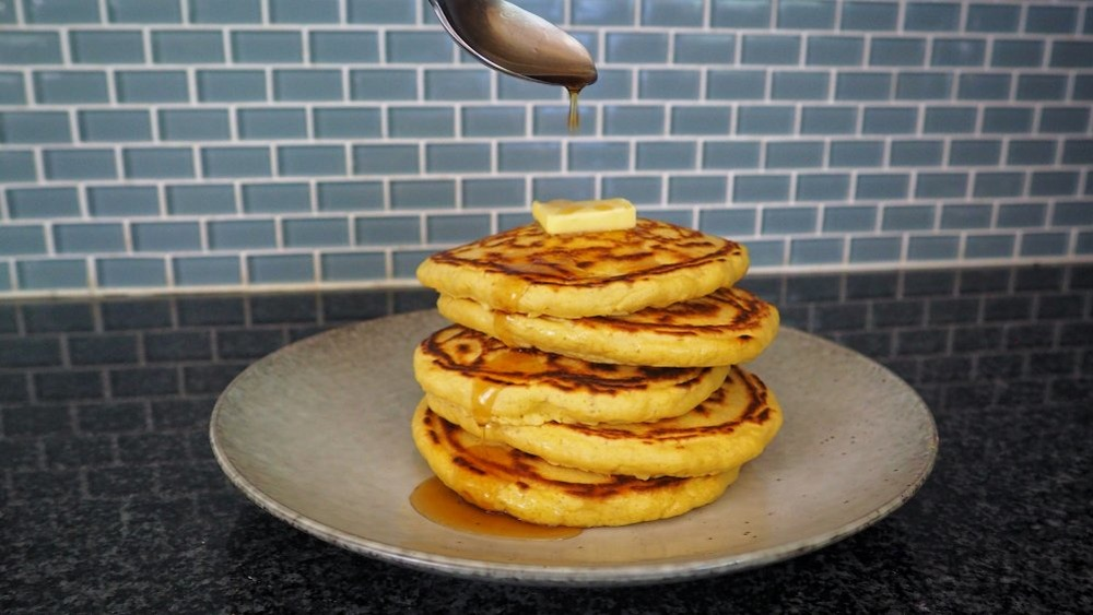 pouring syrup on pancakes
