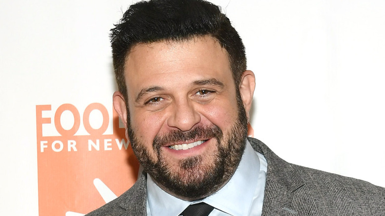 Chef Adam Richman in a suit