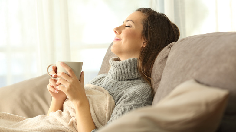 woman relaxing with coffee mug