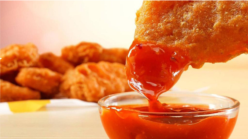 Dipping a Spicy McNugget in sauce