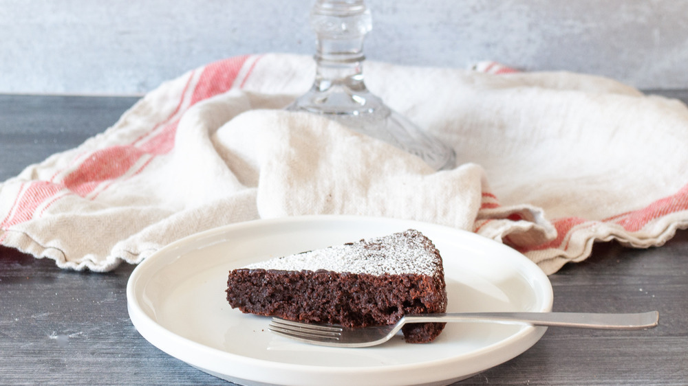 slice of flourless chocolate cake on plate with fork
