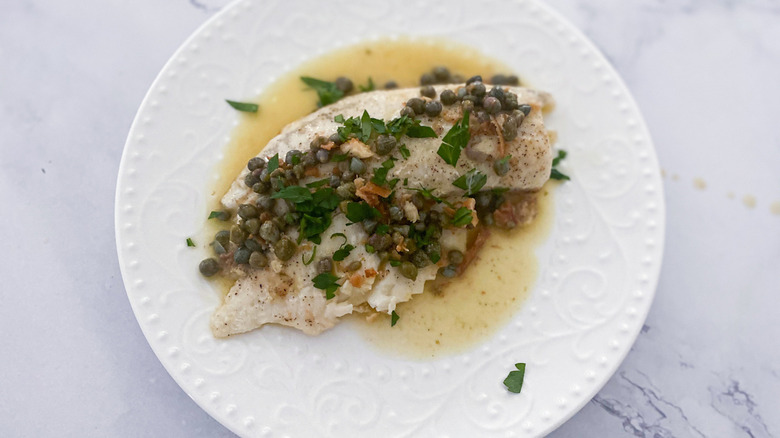 tilapia piccata on a dish