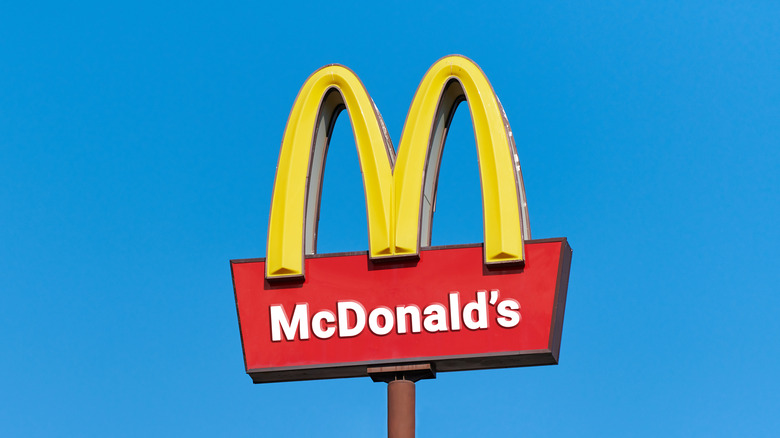 McDonald's yellow arches against blue sky background