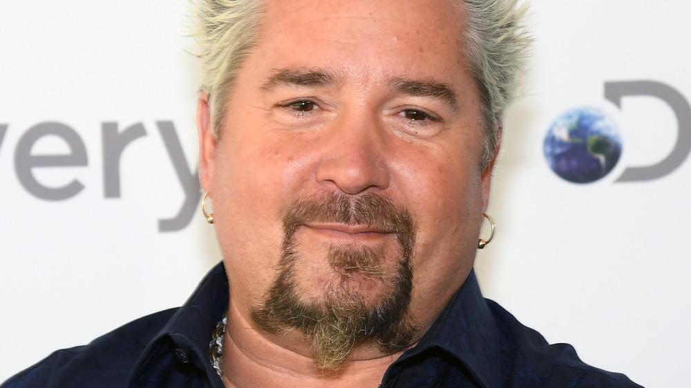 Guy Fieri crossing his arms