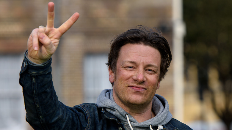 Jamie Oliver flashes a peace sign