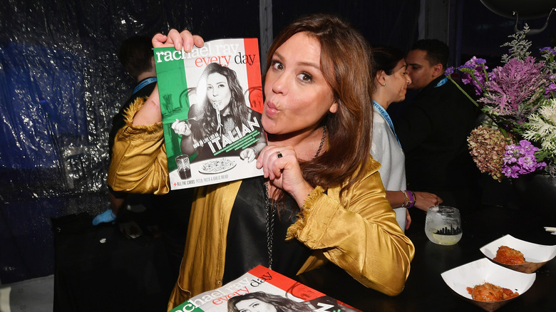 Rachael Ray holding up a magazine