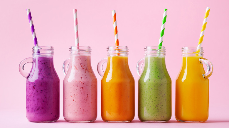 colorful smoothies with straws