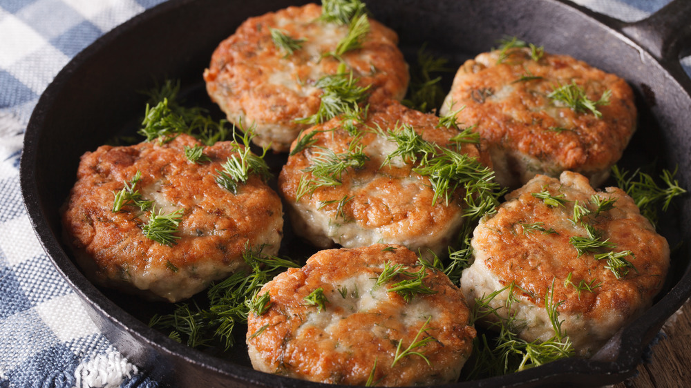 Crab cakes in a cast iron skillet