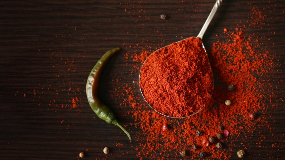 paprika with spoon and pepper