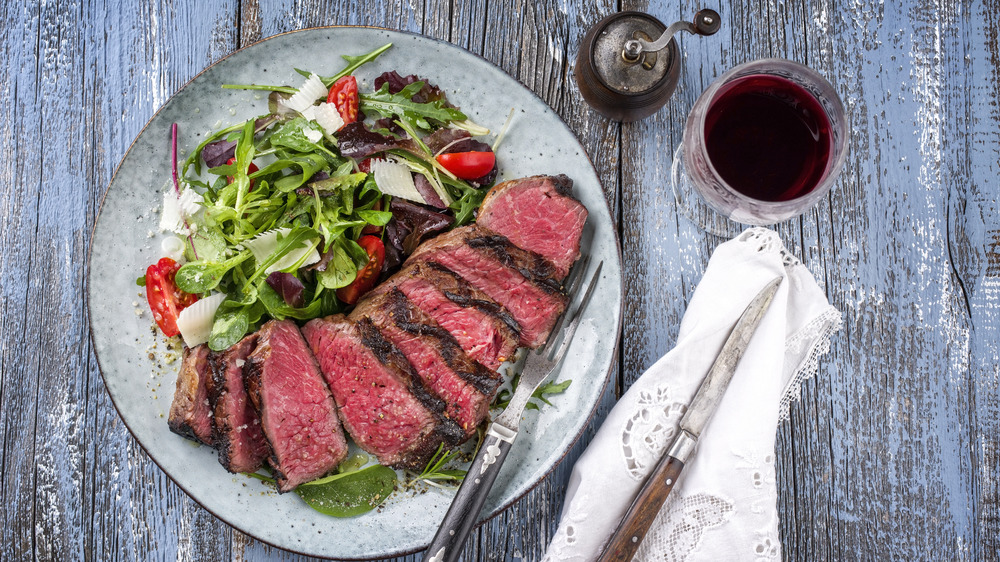 Prime rib on a plate with a salad
