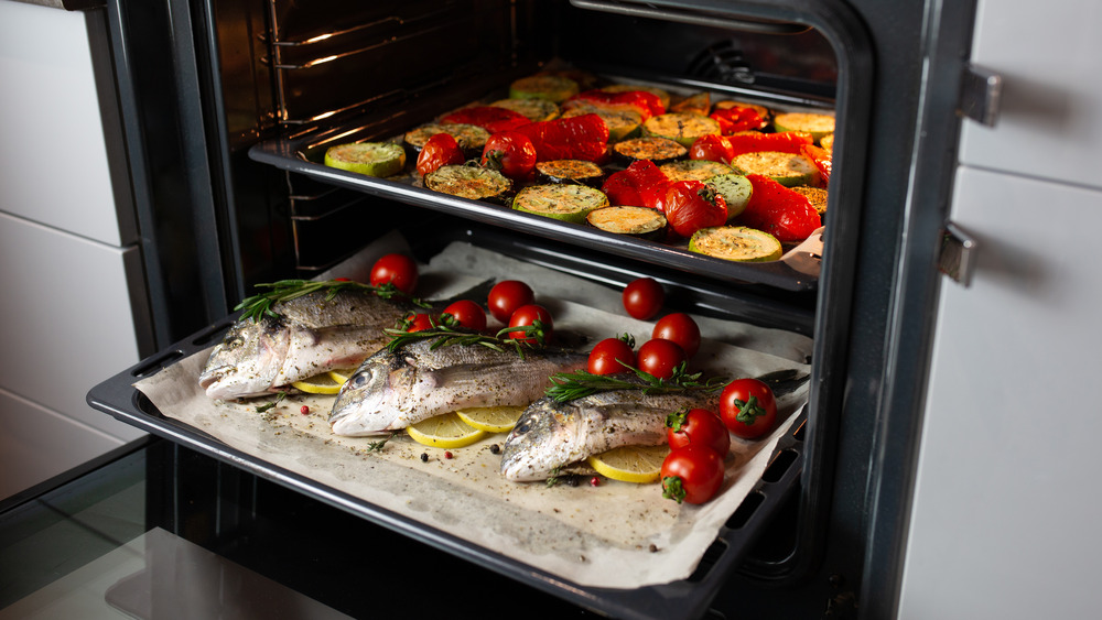 Roasting vegetables and fish in oven