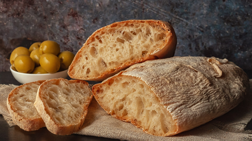 A loaf of ciabatta with olives