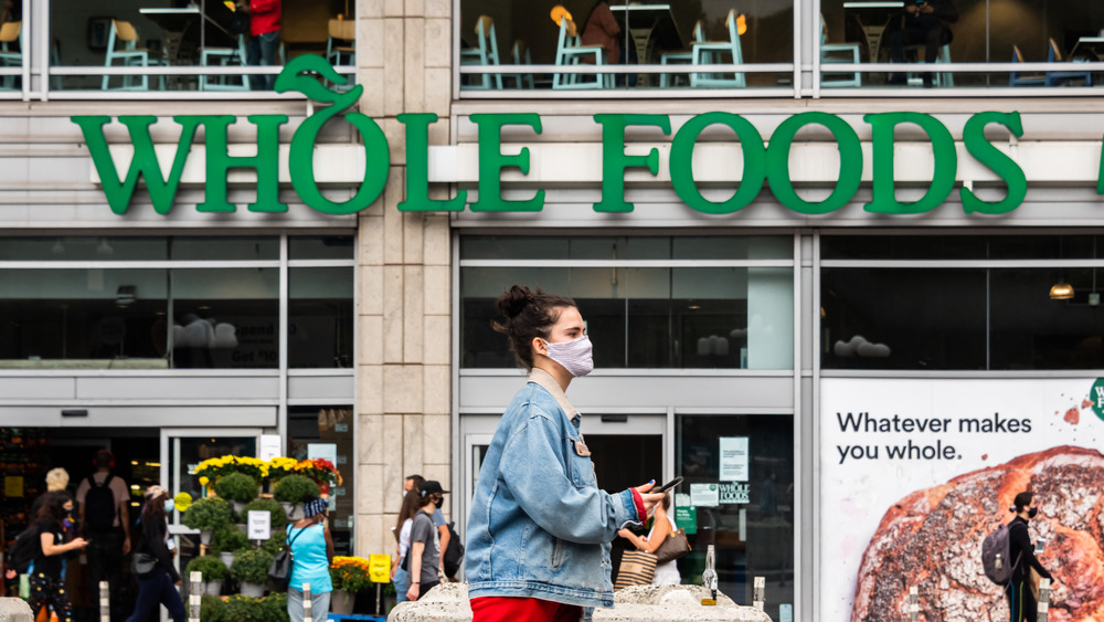 Masked woman walking at Whole Foods