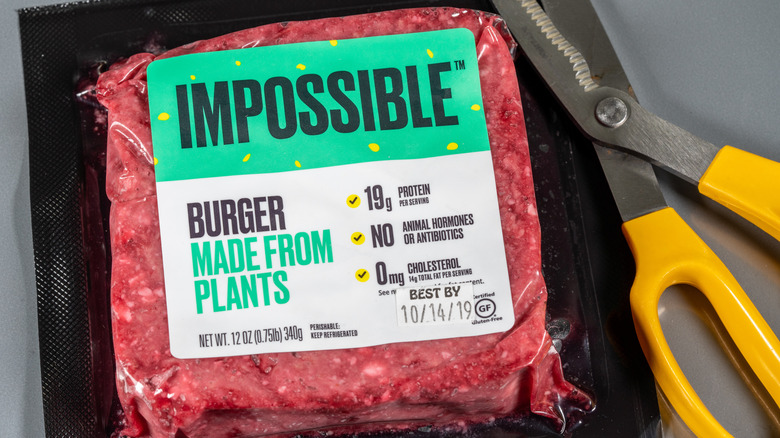 Impossible burger meat and scissors