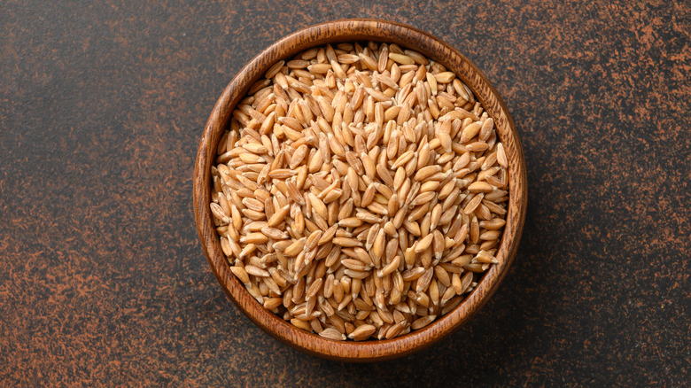 Wooden bowl of farro on table