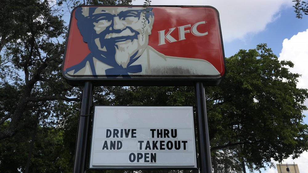 """KFC sign with readerboard: """"drive thru and takeout open"""""""
