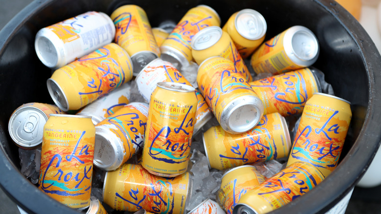 Tangerine LaCroix cans sitting in ice