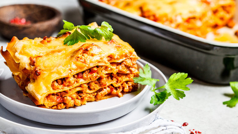 white plate of beef lasagna