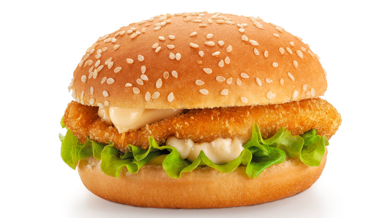 Fried chicken sandwich with lettuce and mayo on sesame seed bun