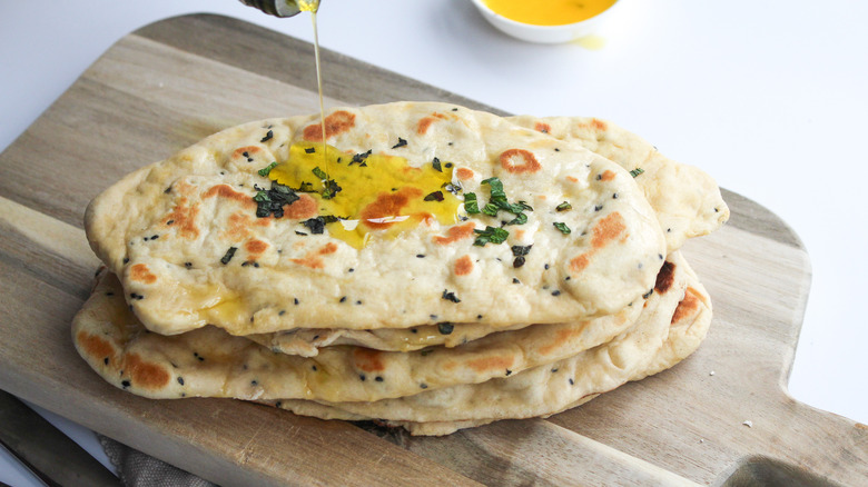 naan recipe with oil pouring
