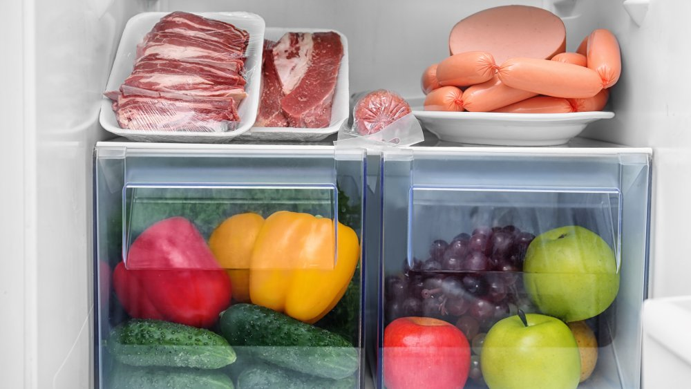 Meat on a shelf in the refrigerator