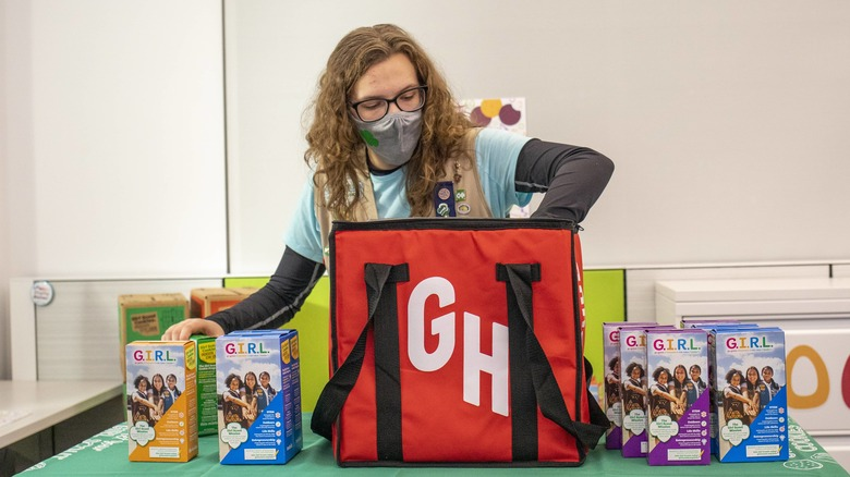 Filling Grubhub bag with Girl Scout cookies
