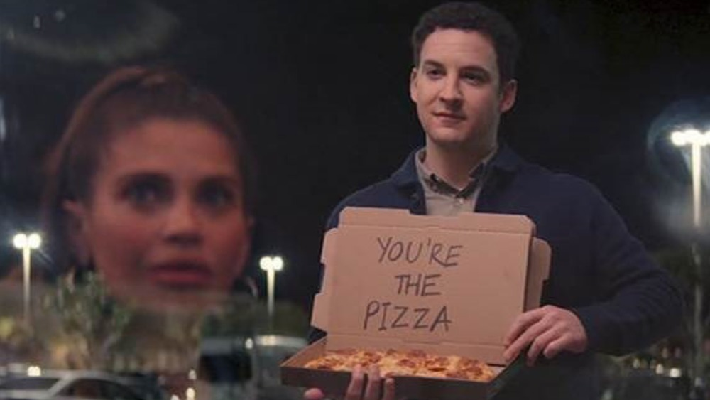 Ben Savage holding pizza box with note
