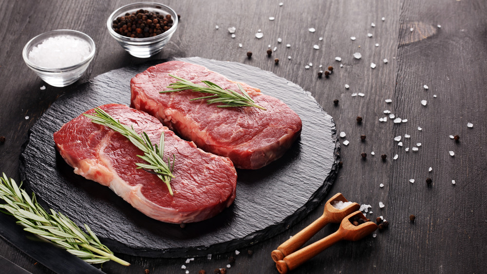 raw steak displayed with spices