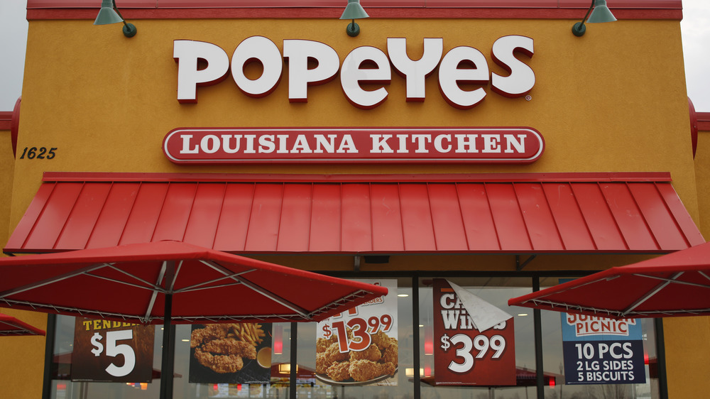 Popeyes storefront with ads
