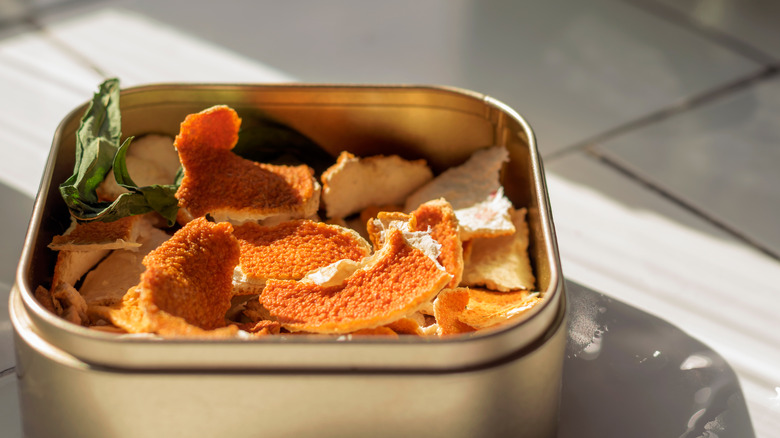 Orange peels in a silver container