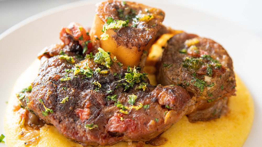 ossobucco on white plate with polenta