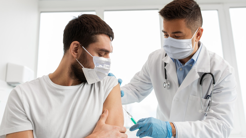 Doctor giving a person a vaccination