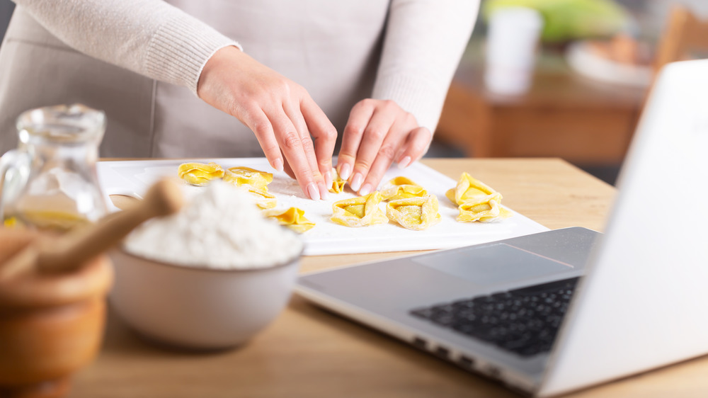 Woman doing virtual cooking lesson