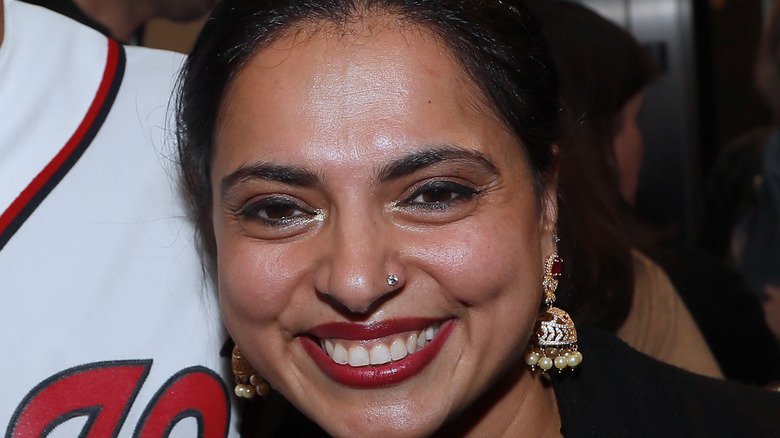 Maneet Chauhan wearing earrings and red lipstick