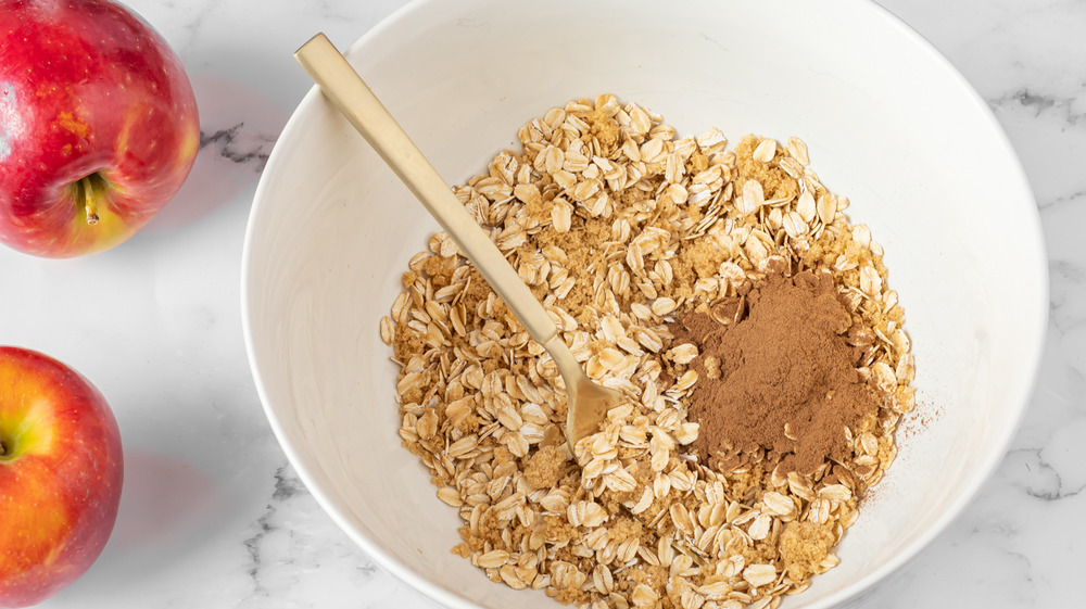 mixing muffin topping for apple cinnamon muffins