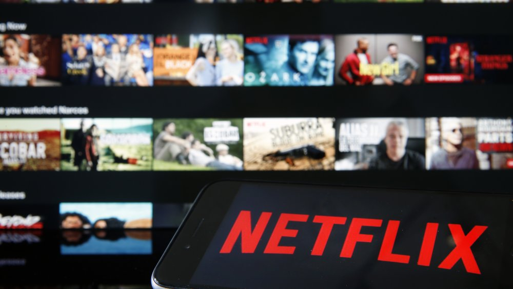 Netflix logo with TV screens in background