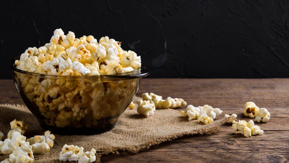 bowl of popcorn on wooden table