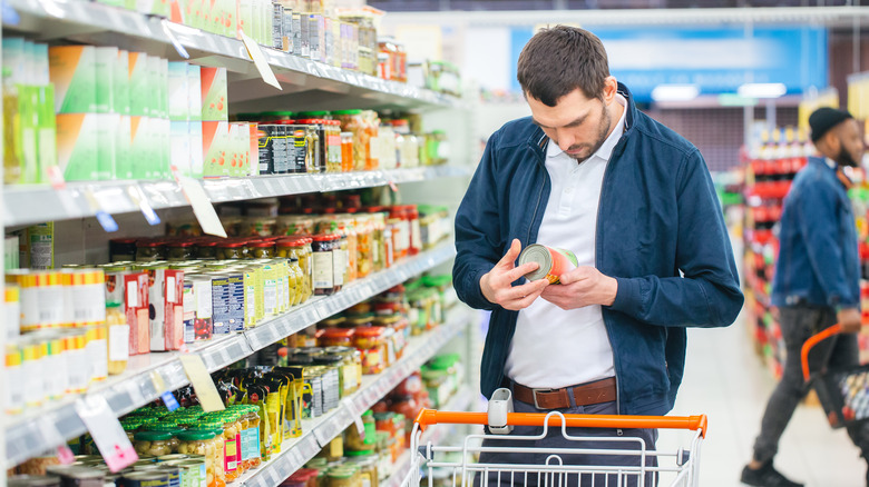 Man inspecting label at grocery store